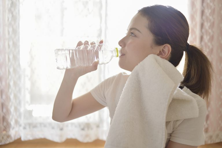 Woman drinking water in the room