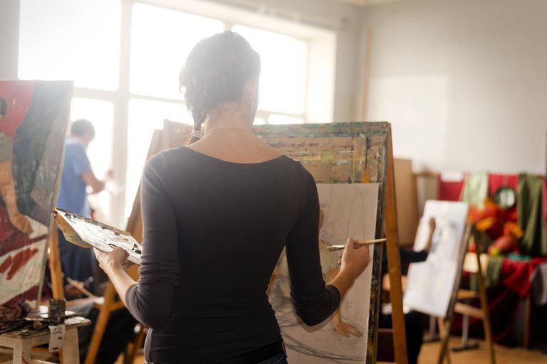 Young Woman Painting in Class room