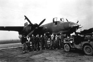 circa 1944: American airmen standing next to their plane. Original Publication: Picture Post - 1661 - American Marauders - unpub.