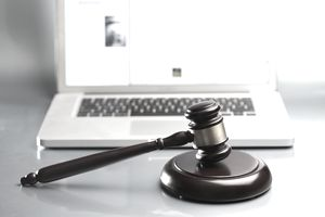 gavel in front of laptop