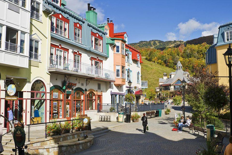 Place Saint-Bernard , in the village of Mont-Tremblant. In the background is the Mont-Tremblant Ski Centre, Laurentians, Quebec, Canada