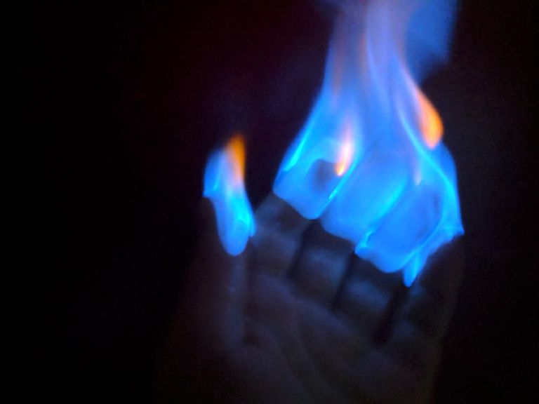 Flame temperature and color depends on the fuel that is being burned. This ethanol and water mixture produces a flame that is cool enough to hold.