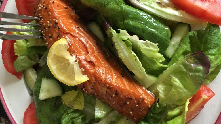 Salmon cutlet on salad