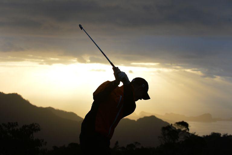Male scratch golfer in silhouette