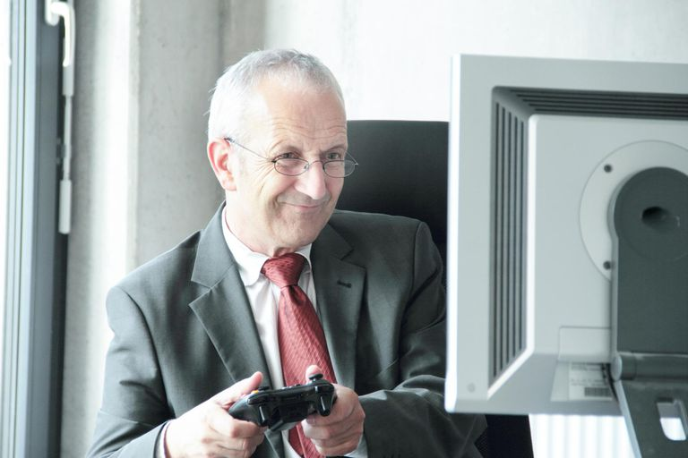 Businessman playing video games at desk