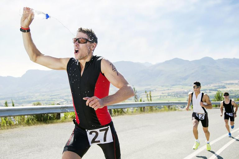 Runner spraying himself with water in race