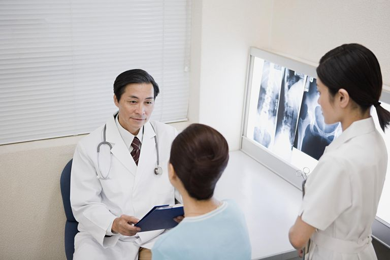 Doctor and patient with x rays
