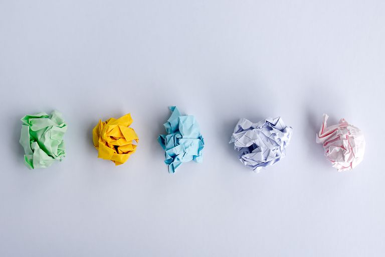 Top view of crumpled papers on white background