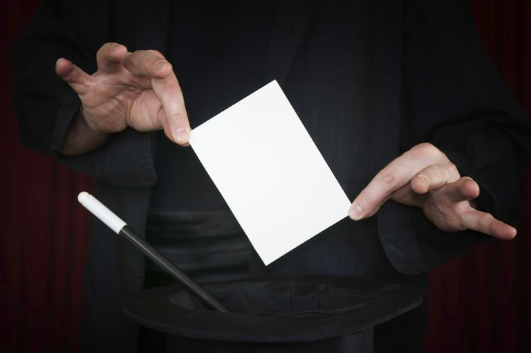 Magician presents blank card