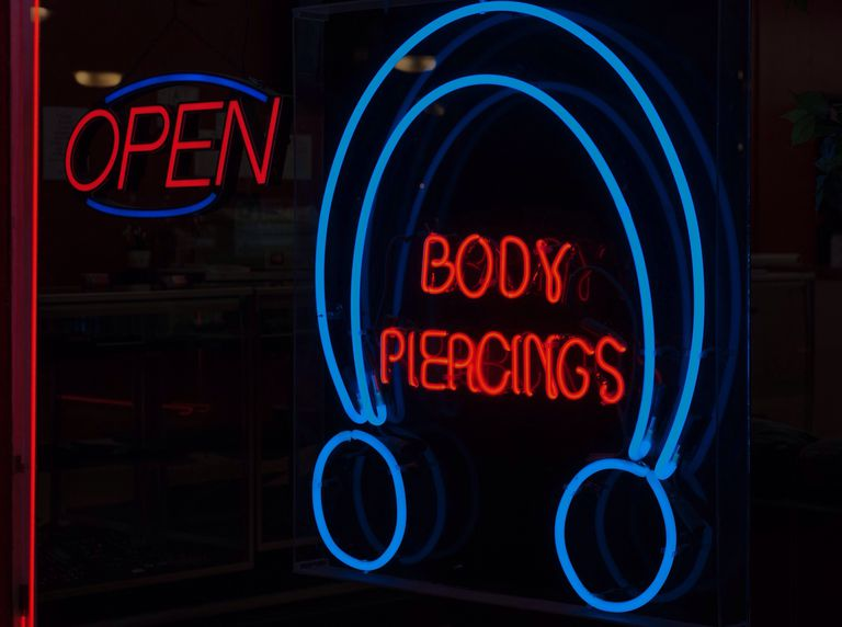 Neon sign for body piercings
