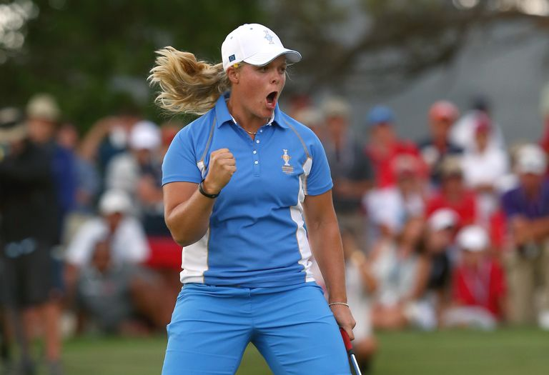 Caroline Hedwall celebrates the winning putt in her singles victory at the 2013 Solheim Cup