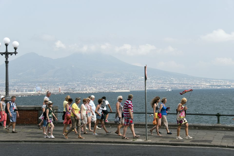 A tour group explores the Bay of Naples in Italy.