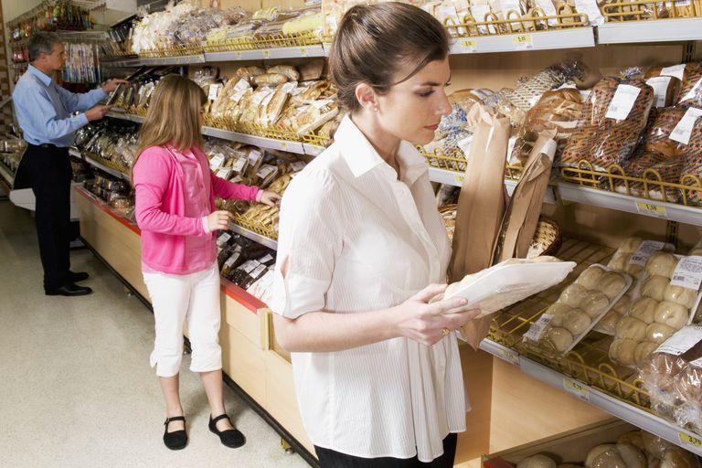 woman selecting bread