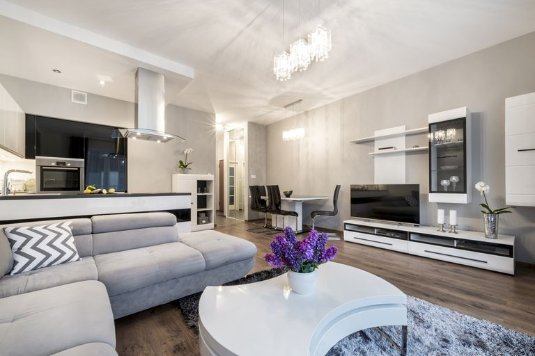 Home Audio Design. An open living room and kitchen area with furnishings audio video  equipment How to Plan Your Whole Home or Multi Music System