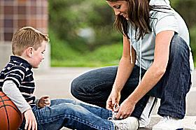 A mom enjoys playing outdoor games with her son.