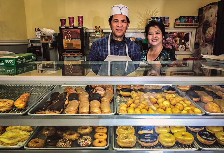 Owners of small bakery with their products