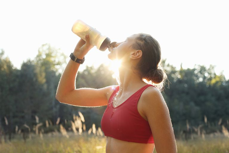 Runner drinking from water bottle