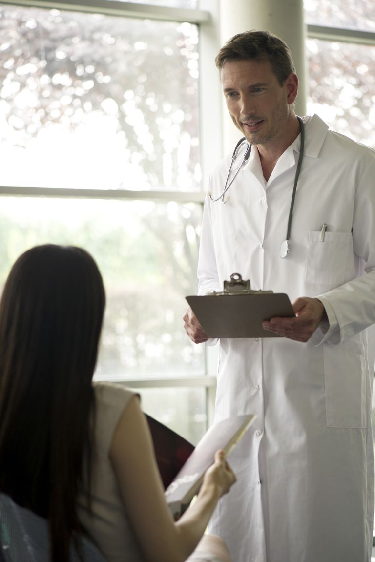 Doctor greeting patient in waiting room