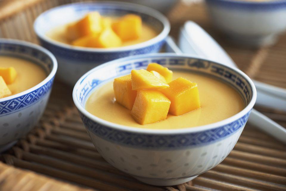 Bowls of Mango Pudding on Tray (Close-up)