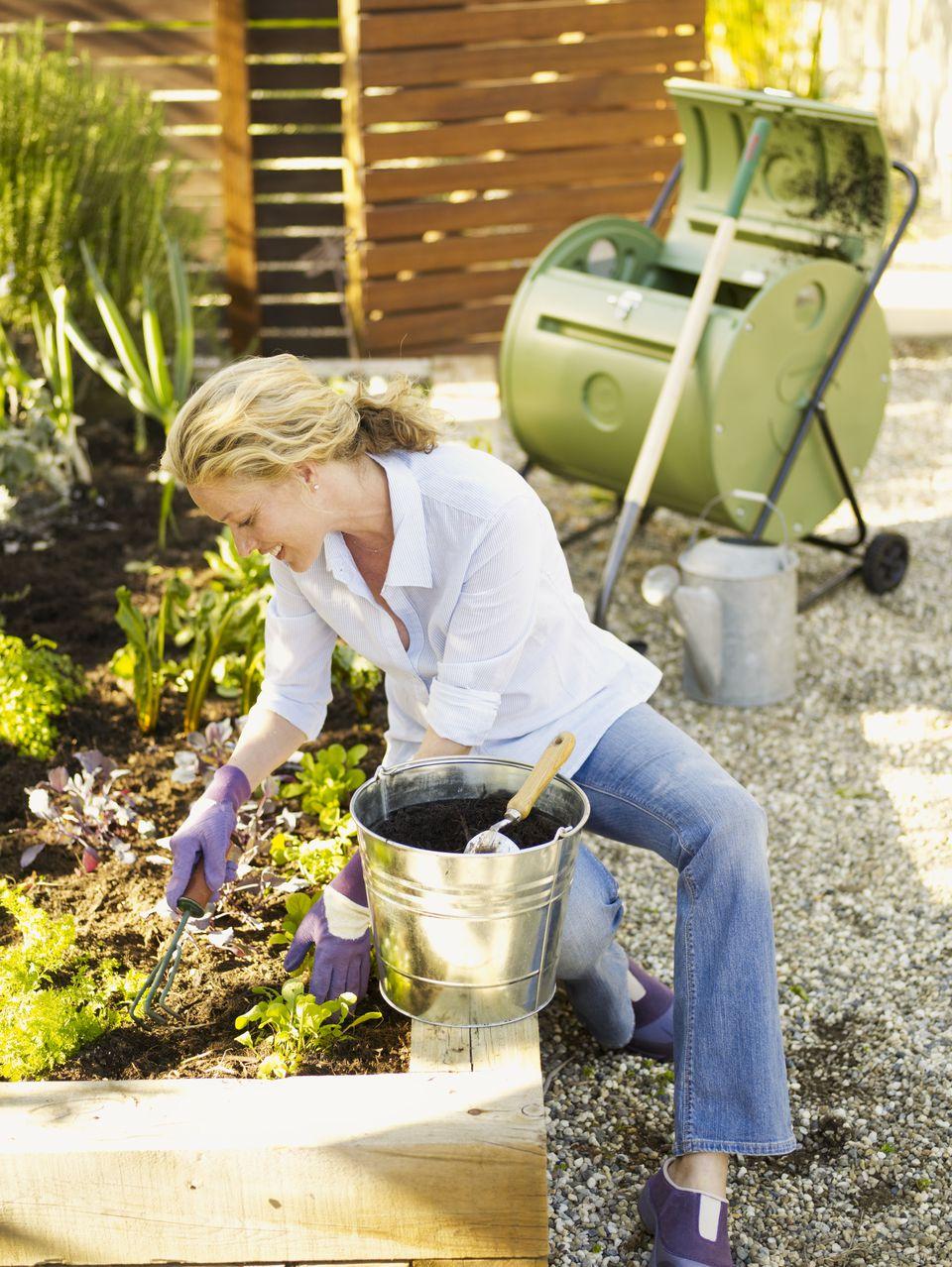Woman gardening & composting