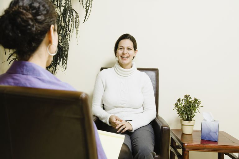 therapist talking to patient