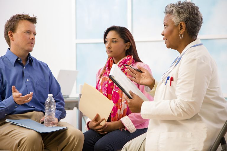 doctor consulting with couple