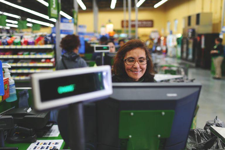Woman checking out customer at Walmart