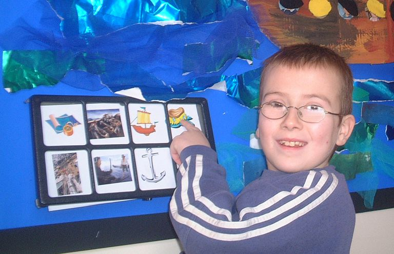 Student using AAC communication board.