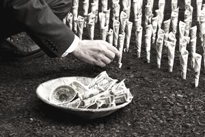 a man harvesting a crop of dollar bills