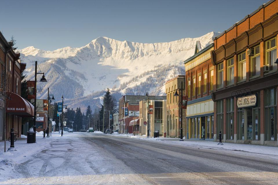 View of Victoria Avenue in downtown Fernie with Fernie Alpine Resort and Lizard Range in background, Fernie, British Columbia, Canada.