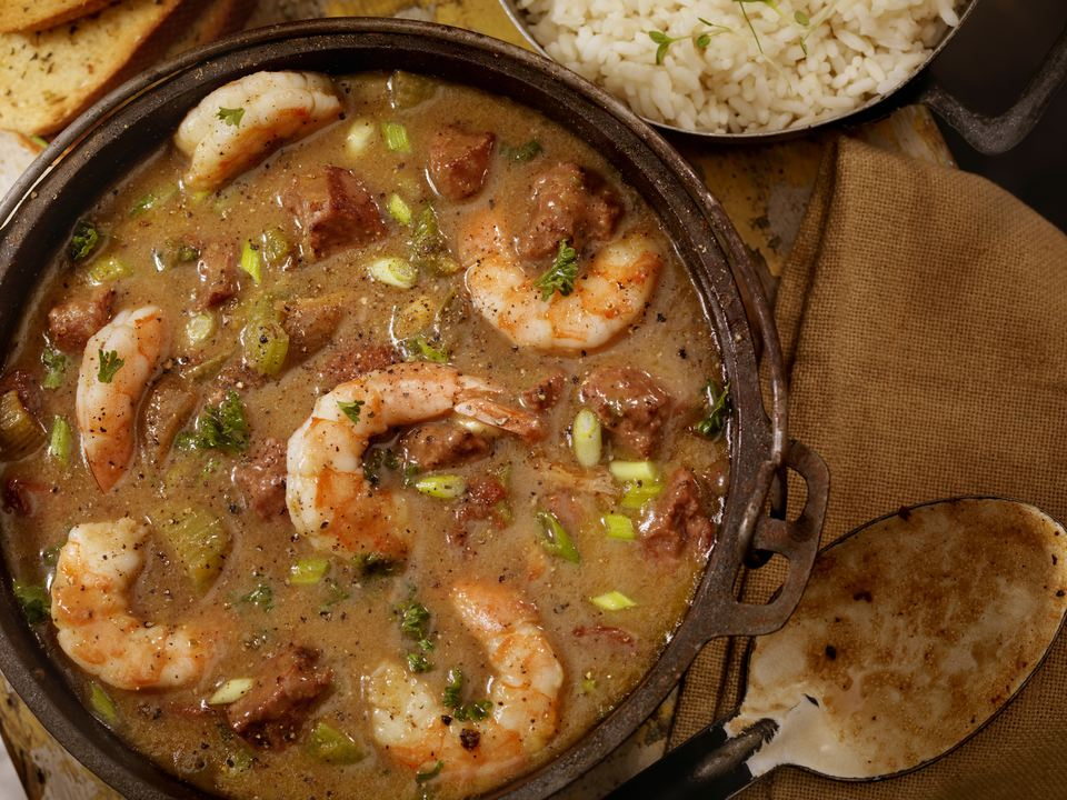 Creole Style Shrimp and Sausage Gumbo in a cast iron pot with White Rice and French Bread