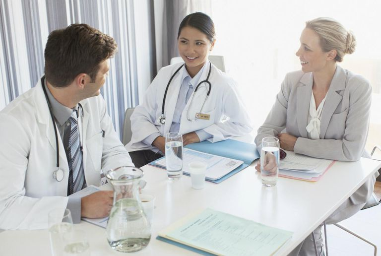 Doctors having discussion with businesswoman