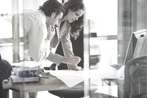 Businesswoman and man working in office