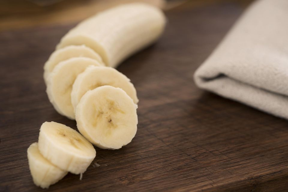 Sliced banana on a chopping board.