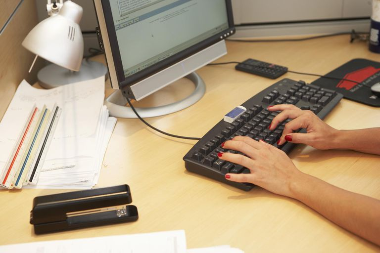 Businesswoman typing on computer keyboard