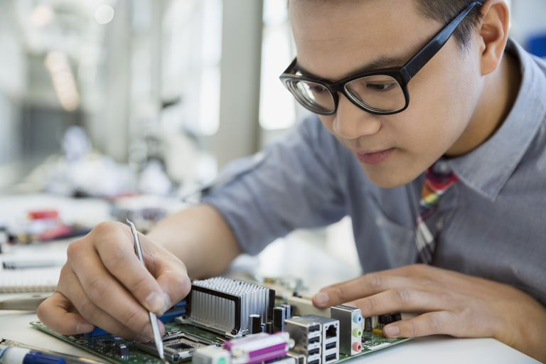 Focused engineer assembling circuit board