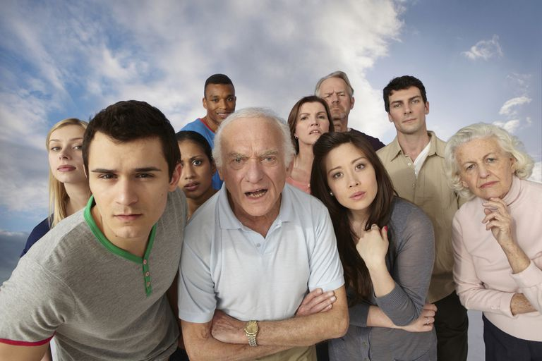 Group of people looking angrily at camera