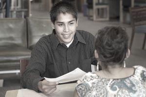 USA, Oregon, Klamath Falls, Native American teenage boy at a job interview