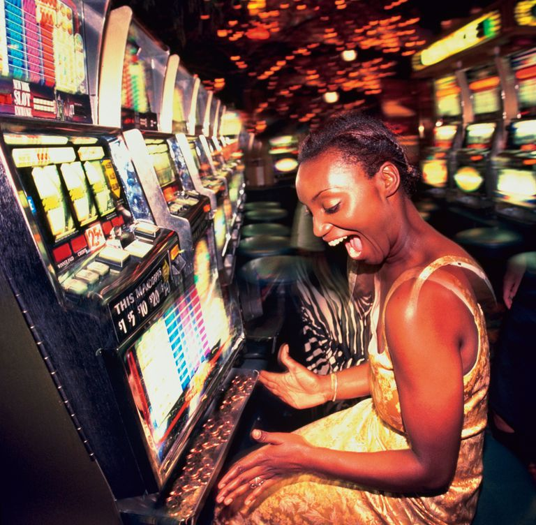 Model poses as woman gambling on slot machine