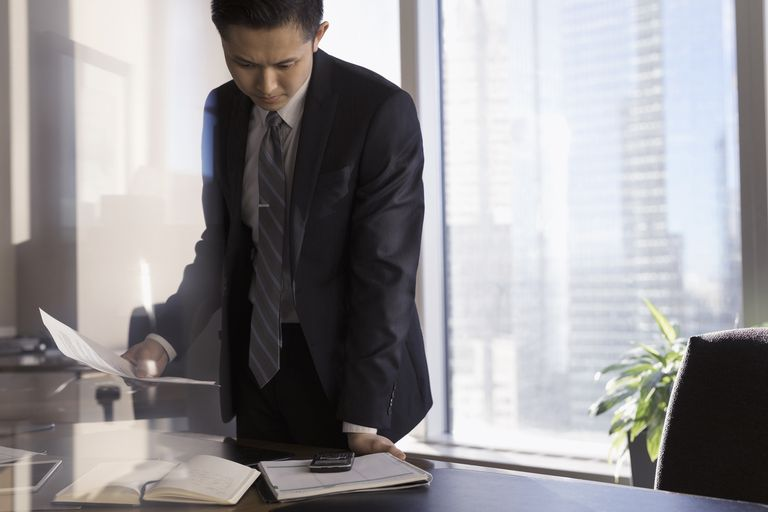 attorney looking at paperwork on desk