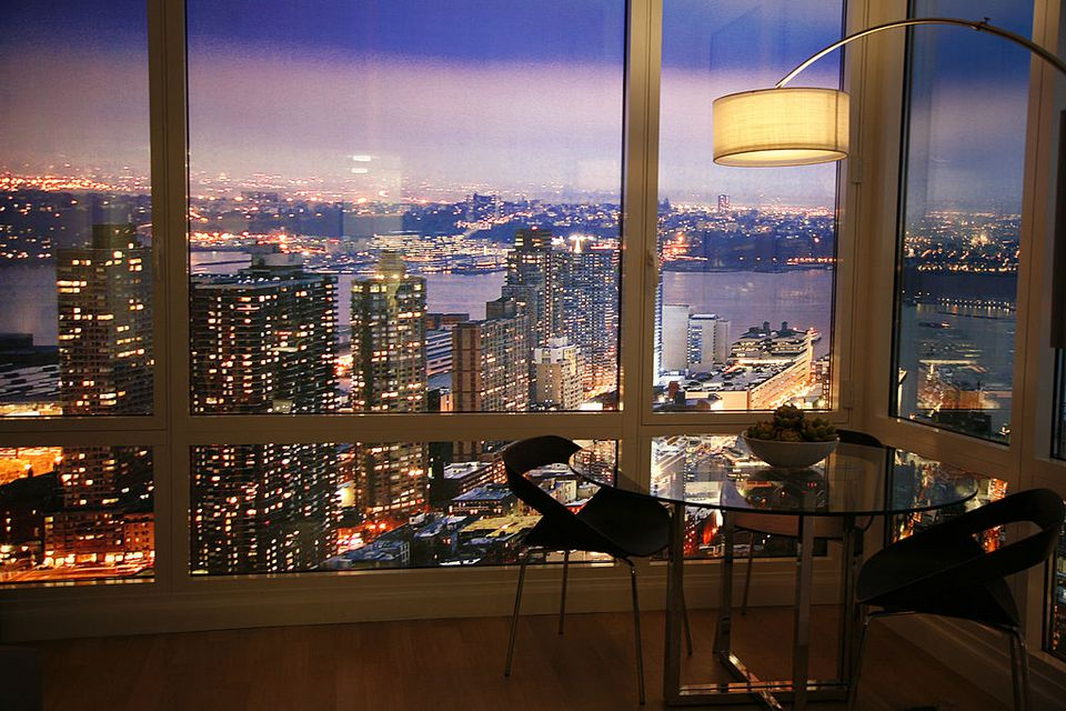 NYC apartment with a view of the city in the nighttime