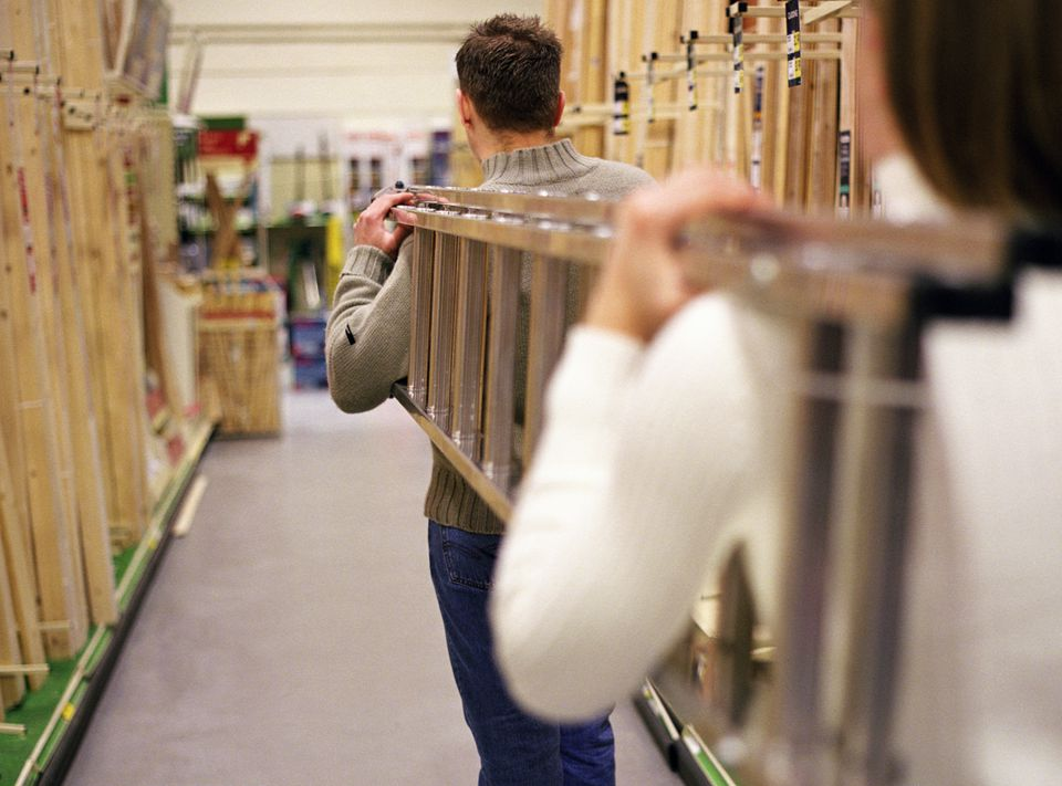 Couple Buying Ladder at Home Improvement Store BA63494