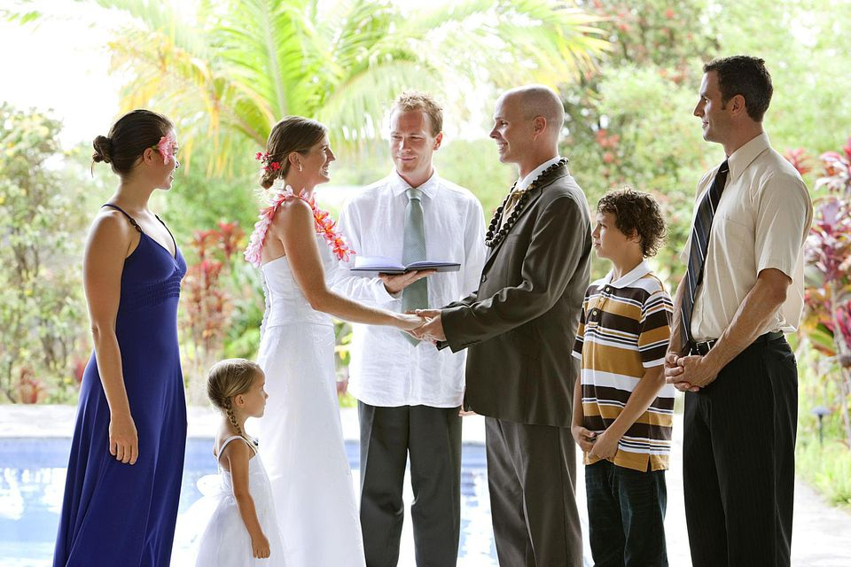 Casual wedding ceremony in tropical location.