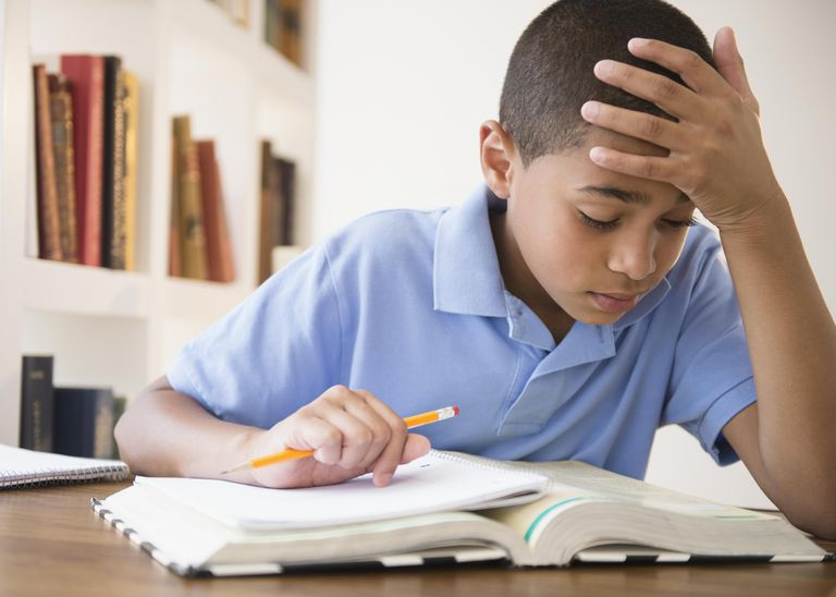 Hispanic boy doing homework