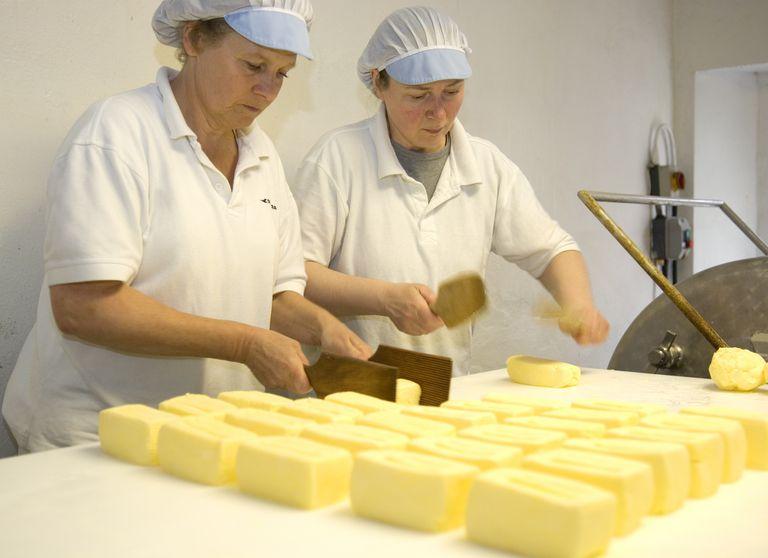 Two women making butter in dairy