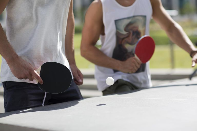 Close up of two men playing table tennis