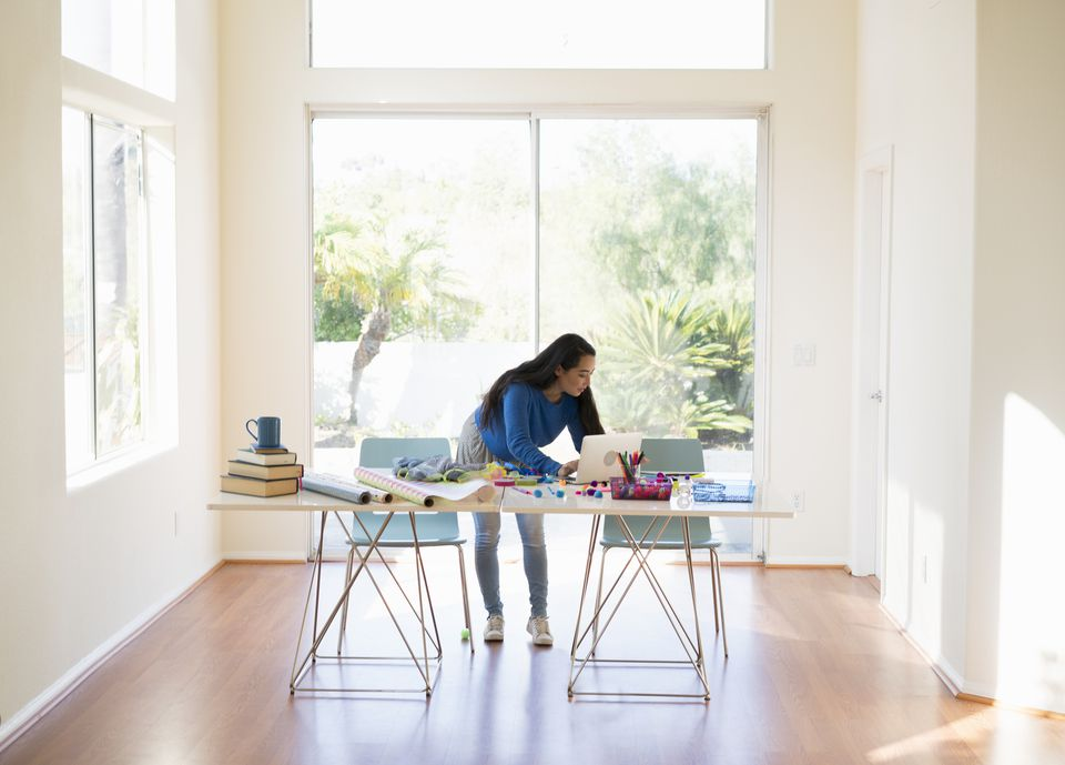 Woman using computer to decorate home