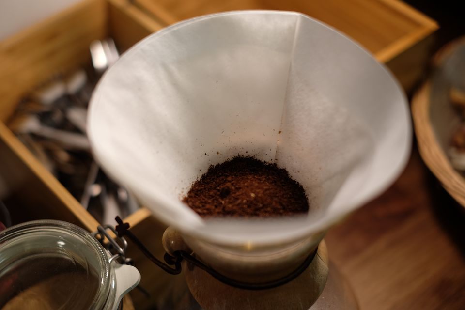 Glass Containing Filter Paper And Ground Coffee