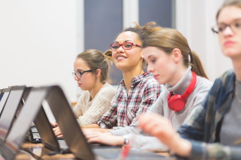 Female students learning computer programming