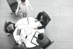 Business people having meeting at table